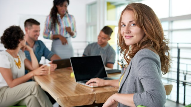 lady-on-laptop-turning-over-shoulder-iStock-532344192
