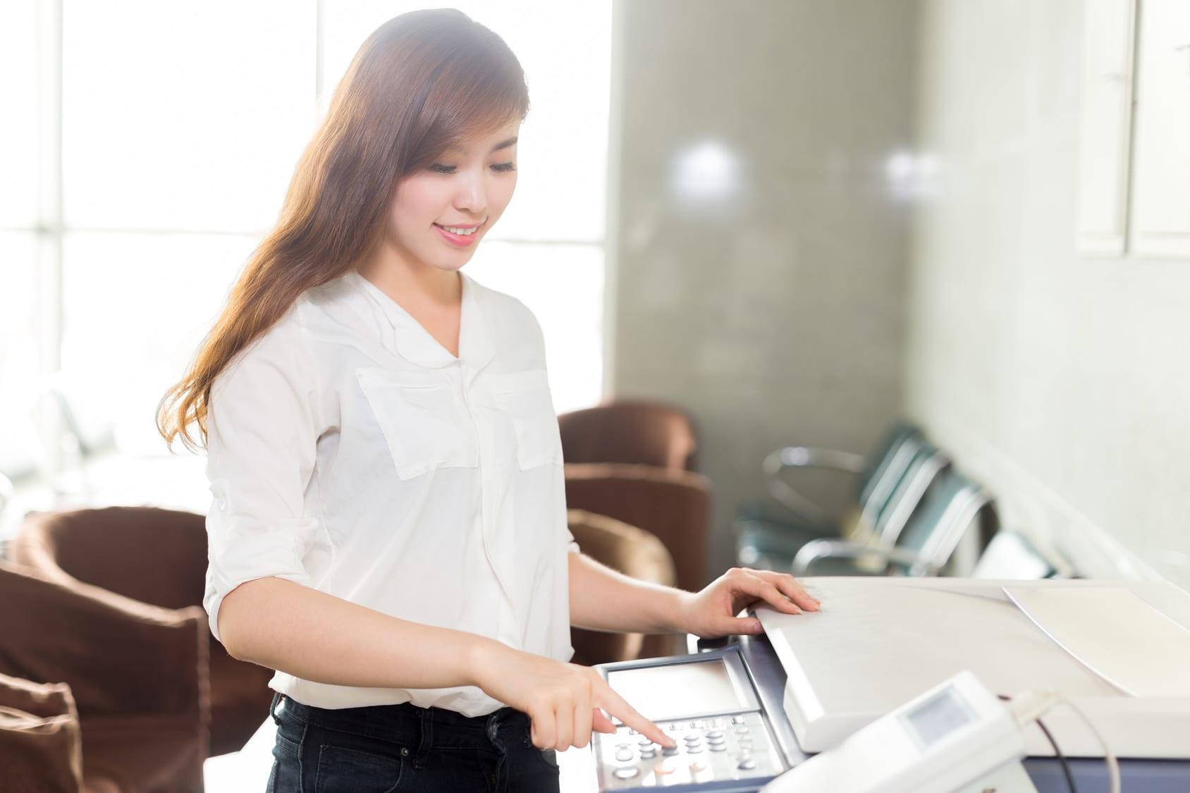 Girl Sitting On Copy Machine