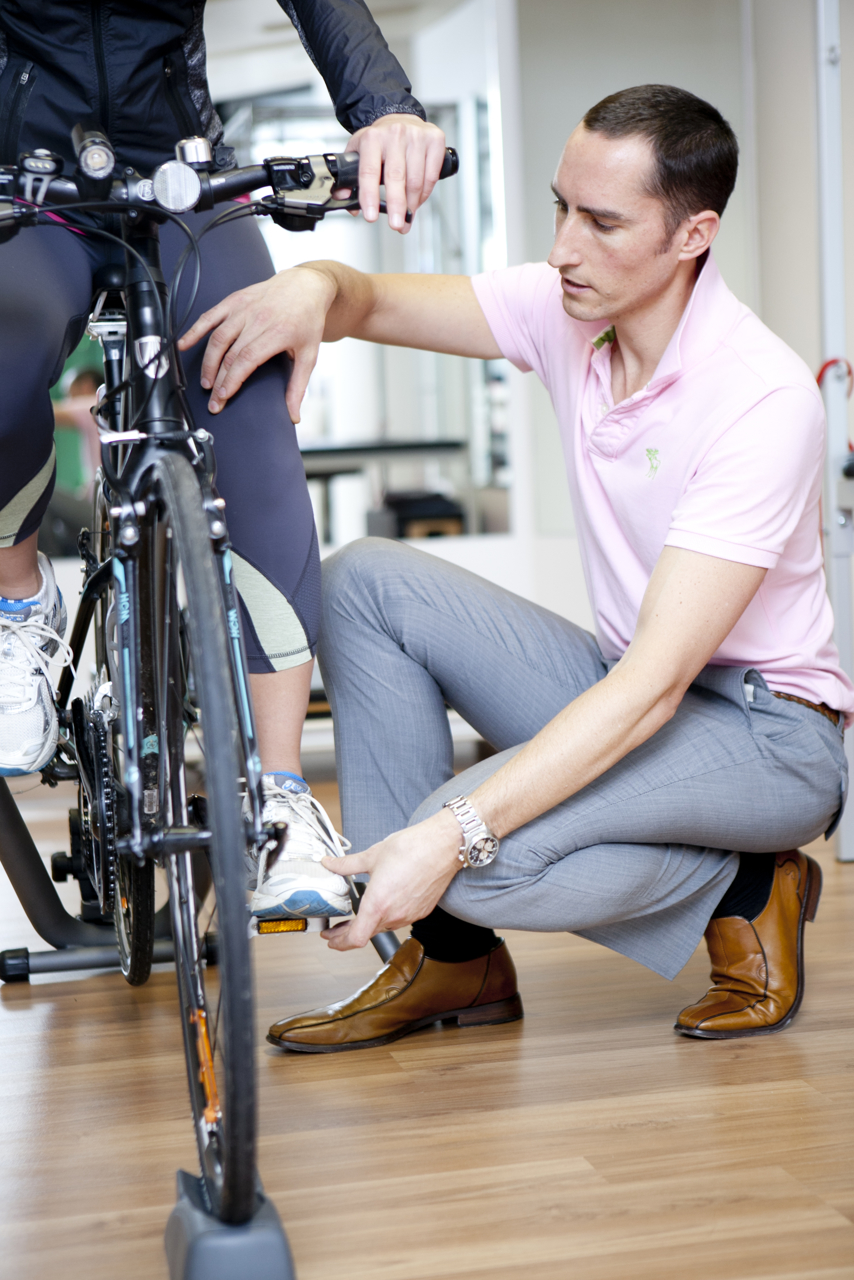 Physio working with client on bike Melbourne