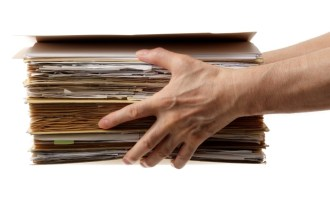 Photo of hands holding documents