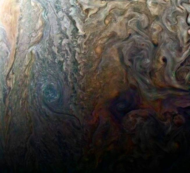 """This enhanced-color image of a mysterious dark spot on Jupiter seems to reveal a Jovian """"galaxy"""" of swirling storms"""