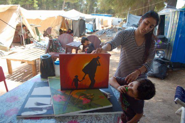 Seve admires her brother's paintings. (Iris Samuels)