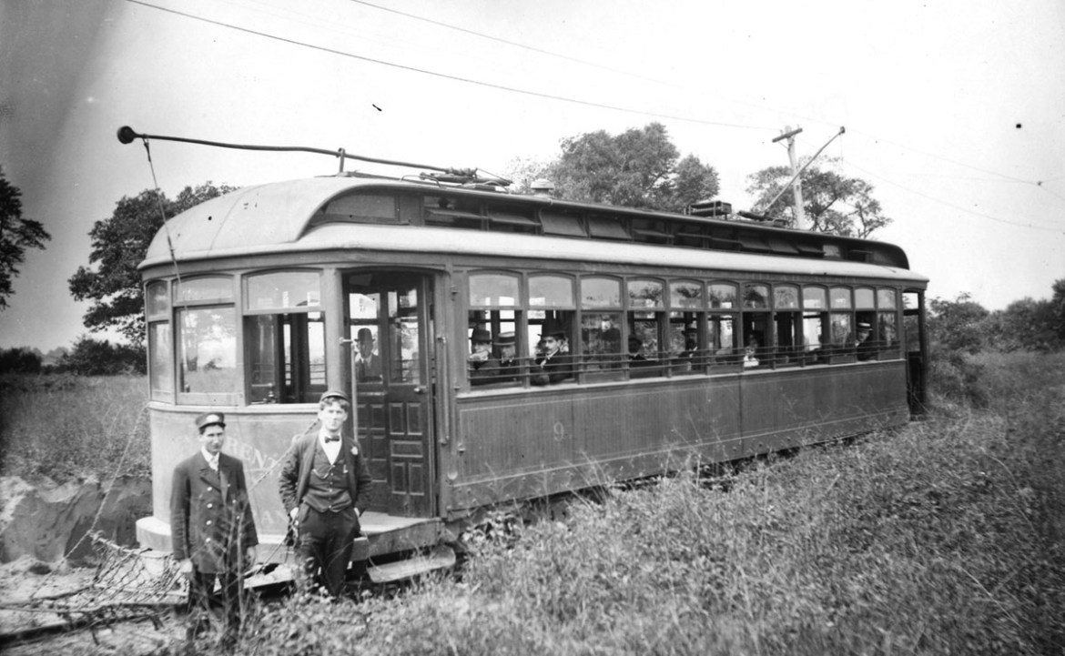 two men standing in front of the train