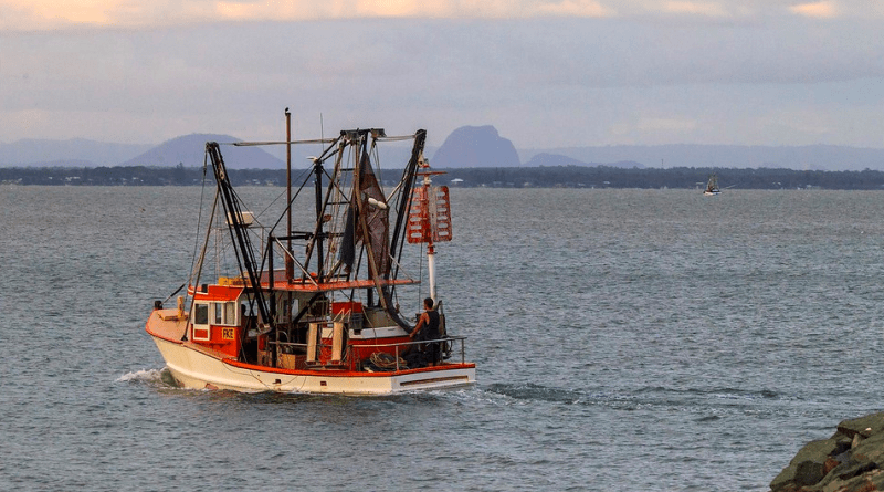 A Scarborough Trawler going fishing at dusk