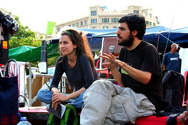 Enric Duran and Nuria Güell during the 15-M occupation of  Plaça Catalunya, Barcelona. Image by Zoraida Roselló
