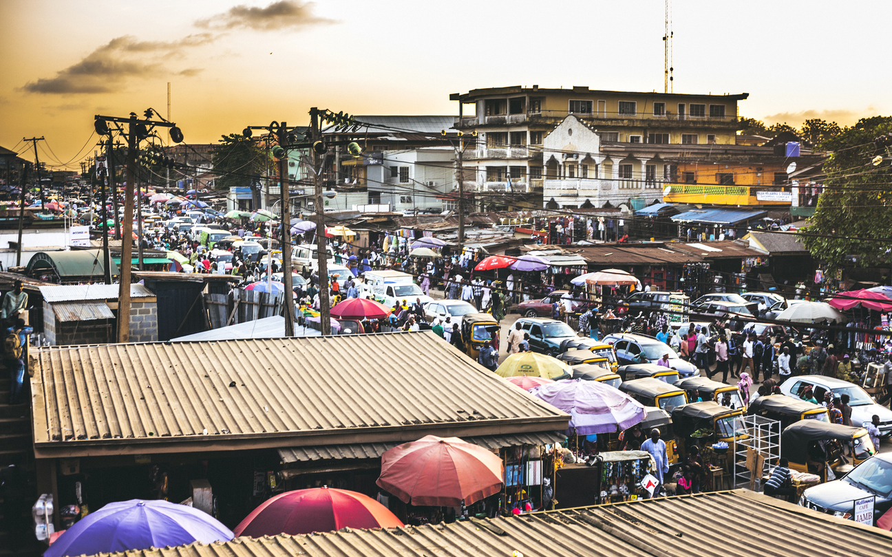 Busy traffic and street market in Ikorodu district.