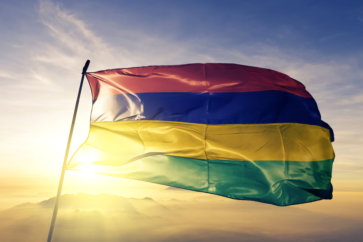 Mauritius Independence, Mauritian flag textile cloth fabric waving on the top sunrise mist fog