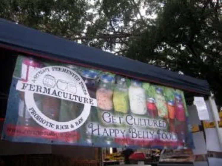 At market with the banner