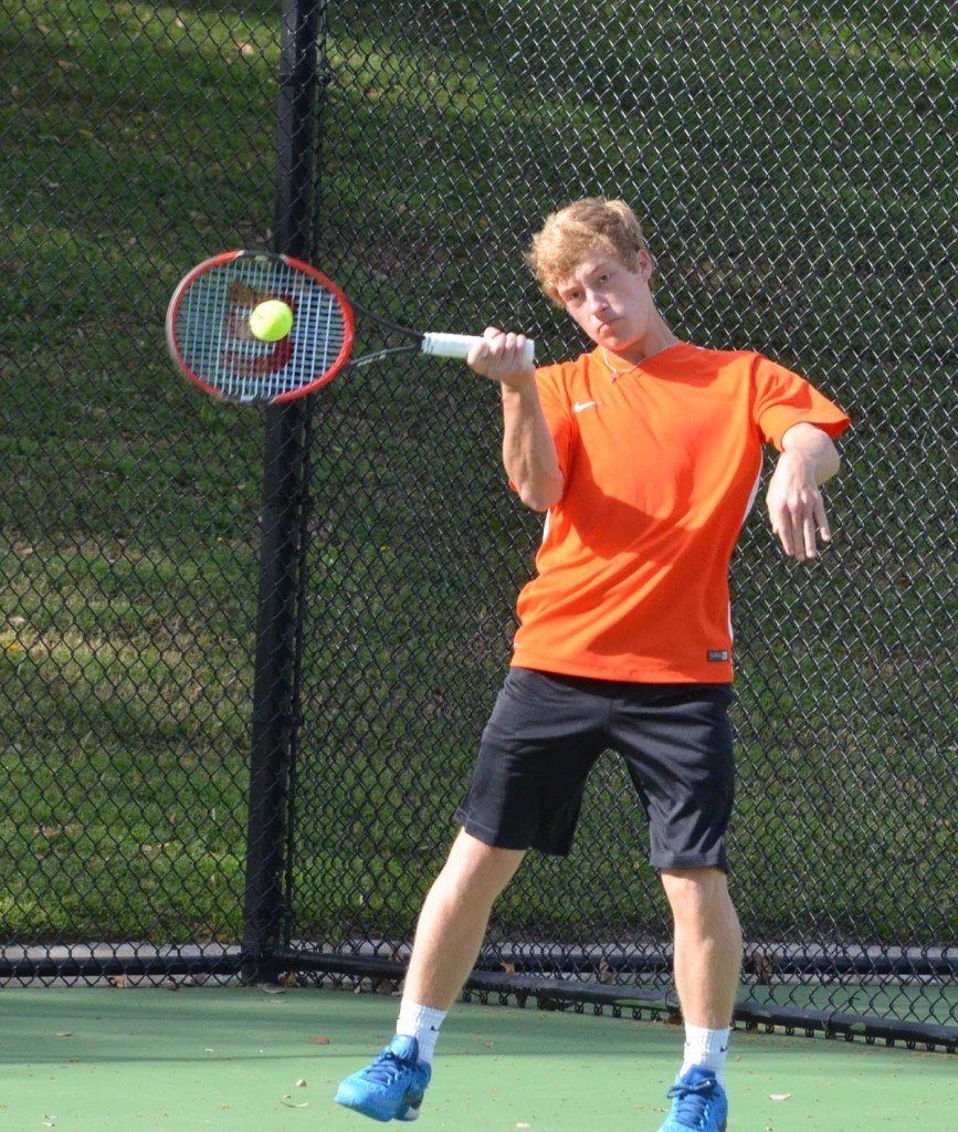 Bearcat Alec Meendsen returns a high volley Friday morning during the championship match of mixed doubles at the District 8-5A tournament at TCU. Meendsen and Nikki Adamie won the mixed doubles championship.