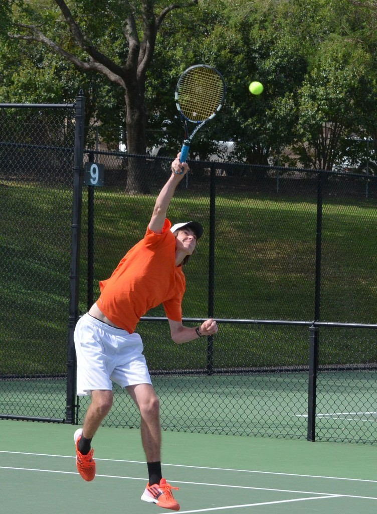 Aledo's Brian Young extends to pound a high return Friday afternoon at the District 8-5A tournament at TCU. Young teamed with Noah Shibley to finish second in boys' doubles and qualify for the regional tournament.