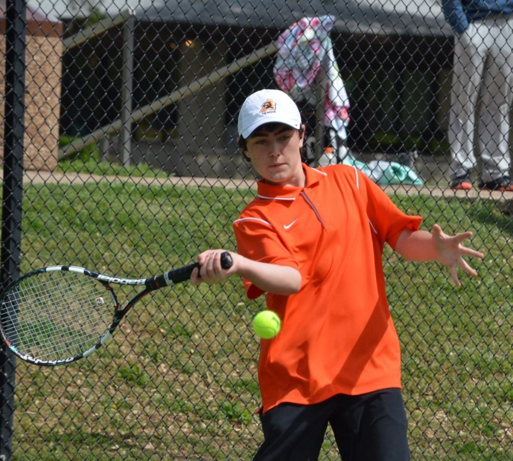 Bearcat Lance McClure focuses on his return Friday afternoon at the District 8-5A tournament at TCU. McClure defeated teammate Miles Grubbs in a playback to earn the second regional-tournament-qualifying spot in boys' singles.