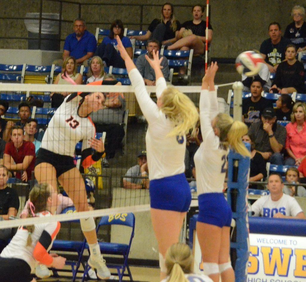 Aledo senior hitter Maddie Goings (13) sends down one of her match-high 27 kills Tuesday night during the Ladycats win over Boswell.