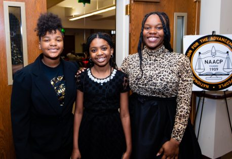 """Samaia Brantley, 13, Destinee Hendricks, 11, and Nadia French-Graham, 18, were the greeters at the """"Men with a Purpose"""" luncheon, a Dr. Martin Luther King, Jr. event celebrating men, at Grace Baptist Church in Waterbury. The event was sponsored by the Waterbury NAACP Youth Council. Jim Shannon Republican-American"""