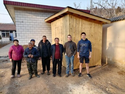 Owen with residents in front of new shed