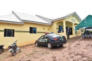 An aerial view of the newly commissioned Harmony Estate Police Divisional Headquarters and a police car