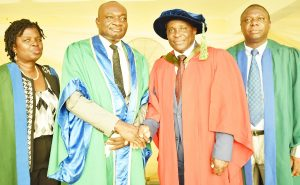 The Vice-Chancellor, Prof. Kolawole Salako (2nd Left) in a warm handshake with the Inaugural Lecturer, Prof. Michael Ozoje (2nd Right) while the Deputy Vice-Chancellor (Academic) Prof. Morenike Dipeolu (Left) and the Registrar, Dr. 'Bola Adekola (Right) look on.
