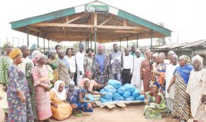 The Vice-Chancellor, Professor Kolawole Salako, flanked from right by the Deputy Vice-Chancellor (Development), Professor Lateef Sanni and from left, by the Babaloja of Fufu Market, Ifo, Alhaji Waheed Lateef and other Principal Officers of the University in a group photograph with fufu market women.