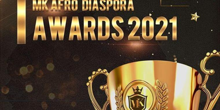 mk afro diaspora awards 2021 logo - gold writing on a black background and a gold trophy