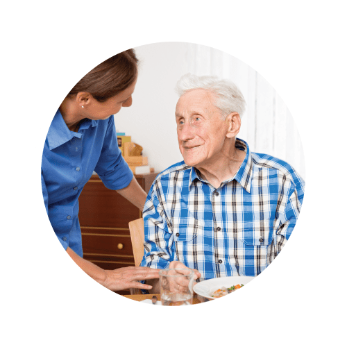 Dietician working with resident who is eating soup