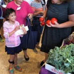 girl with SSO lunch receiving produce