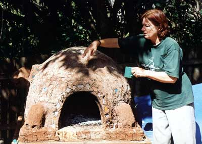 Linda McKee with a newly-comleted cobb oven moulded in the shape of a turtle.