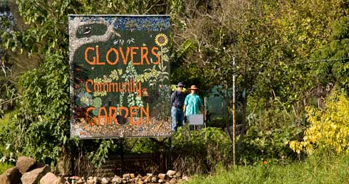 Announcing the presence of Glovers Community Garden is a big, bright sign made as a mosaic. Welcoming signage establishes community gardens in their locale and welcome visitors to see what goes on there. Signs such as this mosaic production can be made as a workshop exercise by the gardeners.