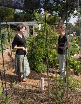 claire nettle (left, South Australian Network coordinator) and Fiona Campbell have a word or two at randwick Community Organic Garden after the AGM of the Australian City Farms & Community Gardens Network.