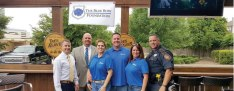 Kimberly and William Colley (center) founded the Blue Bow Foundation in north Houston in 2015.