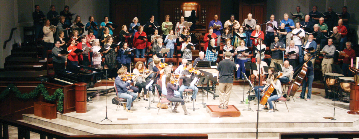 Kevin Klotz, artistic director for the Houston Choral Society, leads a group of 75 singers in about six performances every year.