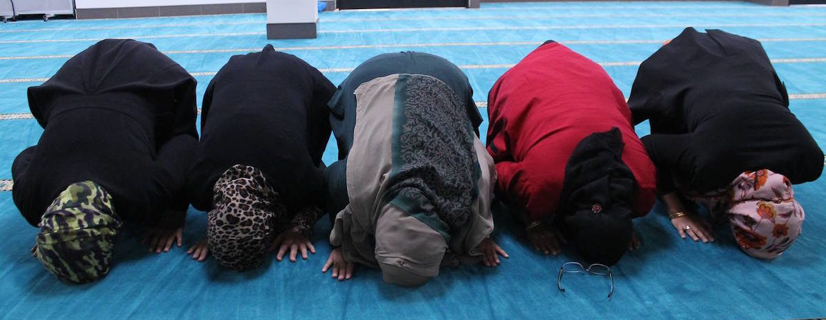 Women pray at the Islamic Center of Frisco in December 2016.