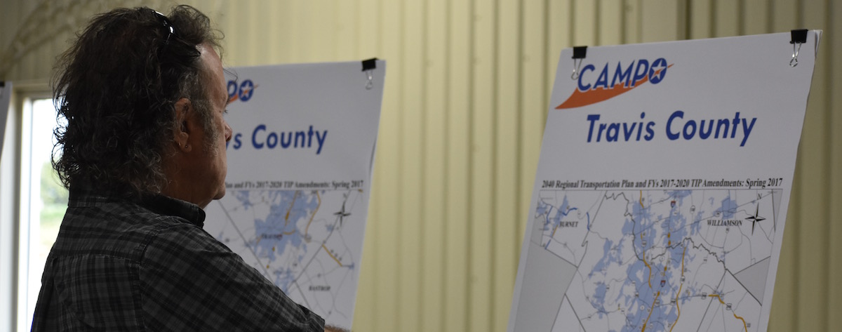 Lakeway resident Tom Delaney reviews transportation plans during a March 21 open house in Dripping Springs.