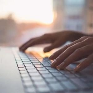 writing on a laptop e