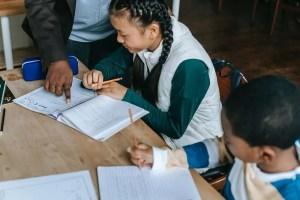 teaching assistant helping children