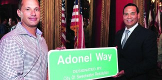Sweetwater honors Adonel Concrete with street signs on NW 110th Ave.