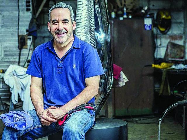 Santiago Medina his stainless steel sculptures.
