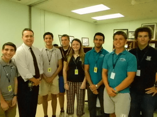 Pictured (l-r) are Daniel Crair; Thomas Ennis, principal; Dario Amador-Lage; Timothy Whiddon; Leila Halley- Wright; Mahmoud Fahmy; Kyle Dickson, and Gianni LaVecchia.