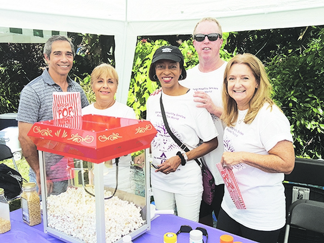 Pictured at Tooth Healer event are members of the Coral Gables Woman's Club and the Men's Auxiliary : Ralph Rivera, Ruth Martinez, Nancy Des Mangles and husband, Brett, and Janet Osgood getting popcorn ready for guests..