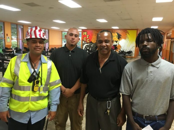 Job Corps alumnus meets at Miami Job Corps with staff and graduates (left to right) Juan Camacho Jr., Site Supervisor, Jesus Rivera, Garrie Ryan, Career Readiness Manager and Hopeton Drummond.