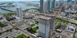 Square Station apartment towers top off construction at 34 stories