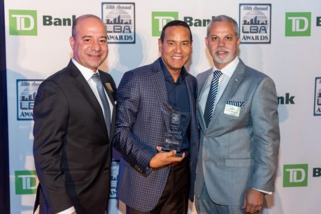 """Luis Garcia, CEO and chair of Adonel Concrete (center), accepts the LBA's """"Member of the Year"""" award from LBA president Eric Montes de Oca (left) and president-elect Erick Valderrama."""