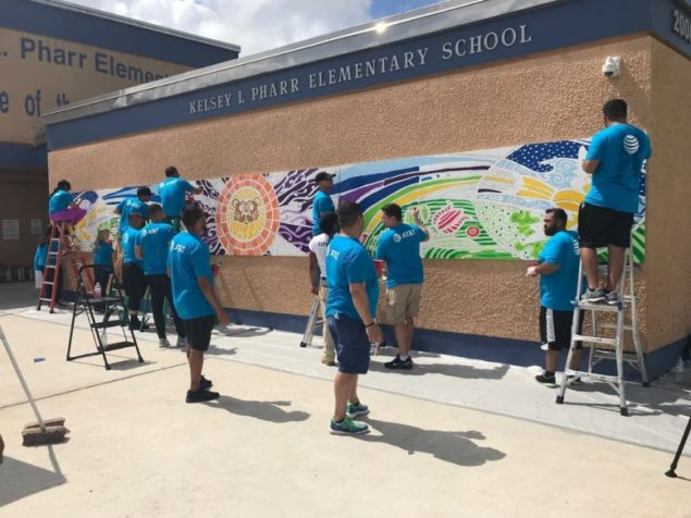 """As part of National Volunteer Month celebrations, about 100 AT&T employees completed a beautification project at Kelsey L. Pharr Elementary School in Miami. City Year, an education organization that helps students and schools succeed, coordinated the project for AT&T. The AT&T volunteers spent their day at the NW 46th Street school: • Painting more than 20 murals themed around inspirational quotes, school pride/school logos and school pillars for success; the murals — ranging in size from 2-by-3 feet to 80-by-8 feet — span the entire school campus; • Painting the teacher's lounge; • Building benches, and • Creating banners with motivational messaging for the cafeteria and teacher's lounge """"AT&T employees are committed to serving their communities across the country,"""" said Joe York, president of AT&T Florida. """"We are thrilled to partner with City Year's Care Force team to help transform schools and neighborhoods into brighter, more vibrant spaces for all."""" The Miami AT&T Day of Service is just one of many marquee volunteer events with City Year's Care Force team happening nationwide and engaging hundreds of AT&T employees. """"We are excited to partner with AT&T to engage employees in high-impact service days to create more welcoming environments for students in communities across the country,"""" said Michael Brown, City Year co-founder and CEO."""