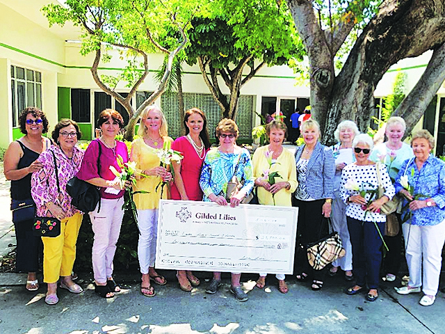 Gilded Lilies present $23,000 check to Easterseals