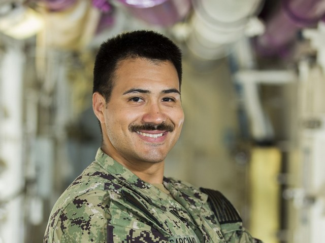 Miami High School graduate serves on nation's newest aircraft carrier