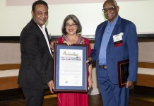 """Miami-Dade Commissioner Daniella Levine Cava (center) presents Anthony Acevedo, CHI Foundation chair, (left) and Brodes H. Hartley Jr., CHI president/CEO, with a proclamation declaring it """"CHI Day."""""""