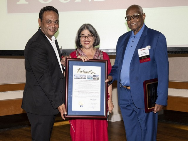 "Miami-Dade Commissioner Daniella Levine Cava (center) presents Anthony Acevedo, CHI Foundation chair, (left) and Brodes H. Hartley Jr., CHI president/CEO, with a proclamation declaring it ""CHI Day."""