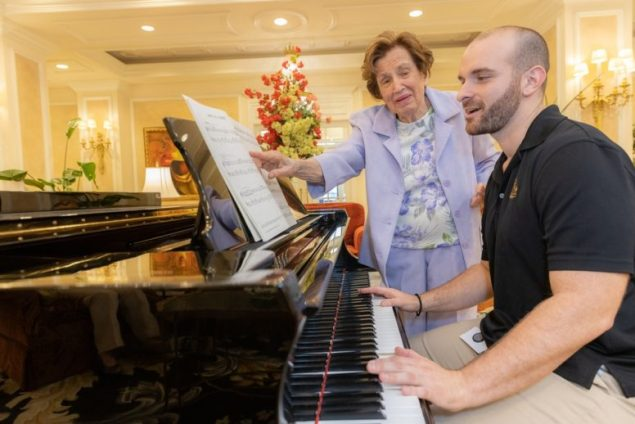 Palace Coral Gables resident shares her love of music with staff member