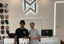 Midway Sports owner Mike Tosar (right) is pictured with Jon Jay, Miami native and Major League Baseball player.
