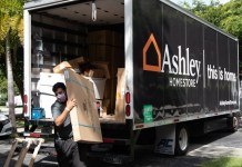 Ashley HomeStore donates 50 twin bed frames, mattresses to hospital, families