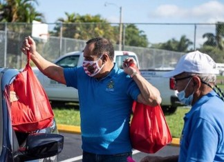 Commissioner Martinez distributes free turkeys to residents in need
