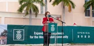 West Kendall Baptist Hospital CEO Lourdes Boue addresses the community as the hospital breaks ground on clinical expansion.
